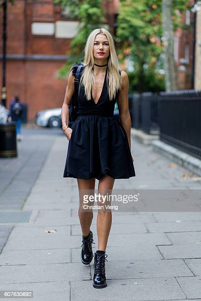 Australian model Jessica Hart wearing a black dress boots and backpack outside Anya Hindmarch during London Fashion Week Spring/Summer collections...