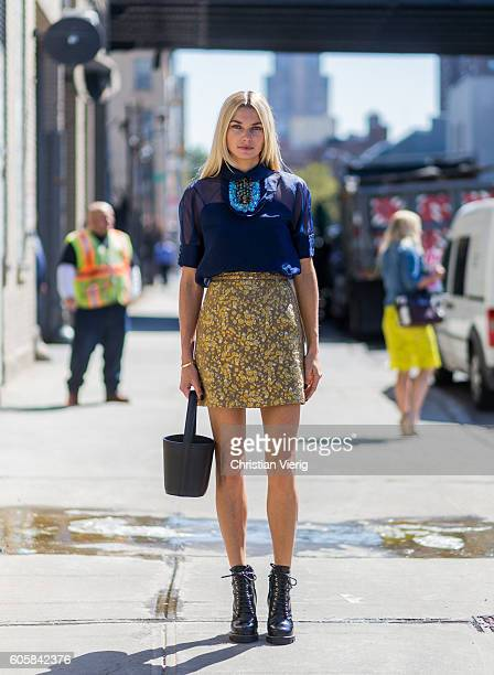 Australian model Jessica Hart wearing a navy blouse, and golden skirt outside Delpozo on September 14, 2016 in New York City.