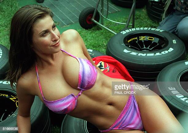 Australian model Jodie Meares girlfriend of media tycoon James Packer sports a bikini in the Williams' garage on the eve of the first qualifying...