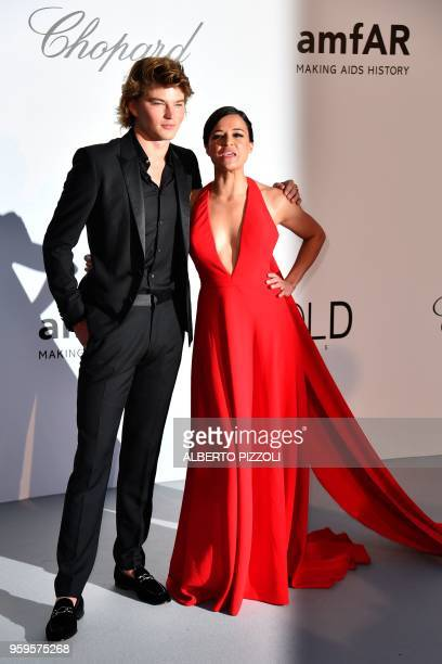 Australian model Jordan Barrett and US actress Michelle Rodriguez arrive on May 17 2018 for the amfAR 25th Annual Cinema Against AIDS gala at the...