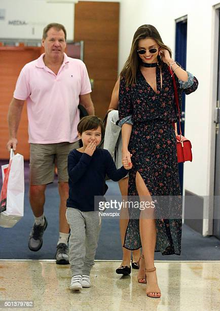 Australian model Miranda Kerr and her son Flynn are met by her parents John and Therese as they arrive at Sydney Airport in Sydney New South Wales
