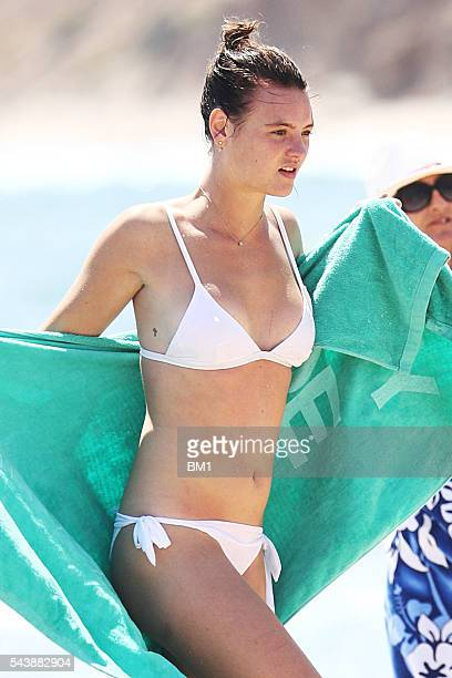 Australian model Montana Cox enjoys a surf in The Hamptons on June 26 2016 in New York