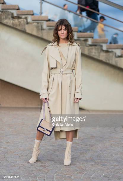 Australian model Montana Cox wearing a trench coat outside Dion Lee during MercedesBenz Fashion Week Resort 18 Collections at Sydney Opera House on...