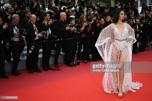 Australian model Shanina Shaik poses as she arrives for the screening of the film Sibyl at the 72nd edition of the Cannes Film Festival in Cannes...