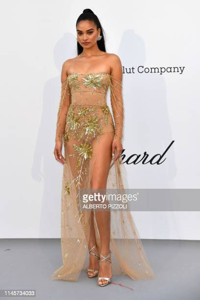 Australian model Shanina Shaik poses as she arrives on May 23, 2019 for the amfAR 26th Annual Cinema Against AIDS gala at the Hotel du Cap-Eden-Roc...