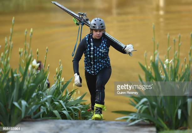 Australian mogul skier Britt Cox walks back up to the top of the water jump during an Australian Ski Jump training session on October 31 2017 in...