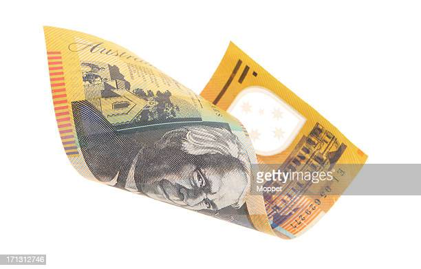 Australian money curled into loose roll on white background