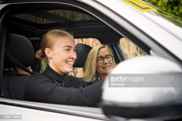 australian mother and daughter bonding - driving stock pictures, royalty-free photos & images