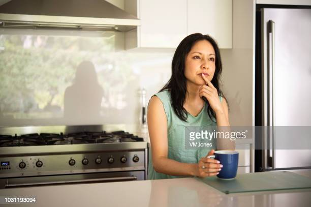 australian mother breakfast time - contemplation family stock pictures, royalty-free photos & images