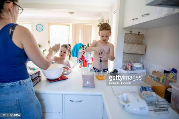 australian mother of two young children in her family home participating in domestic life activities - domestic life imagens e fotografias de stock