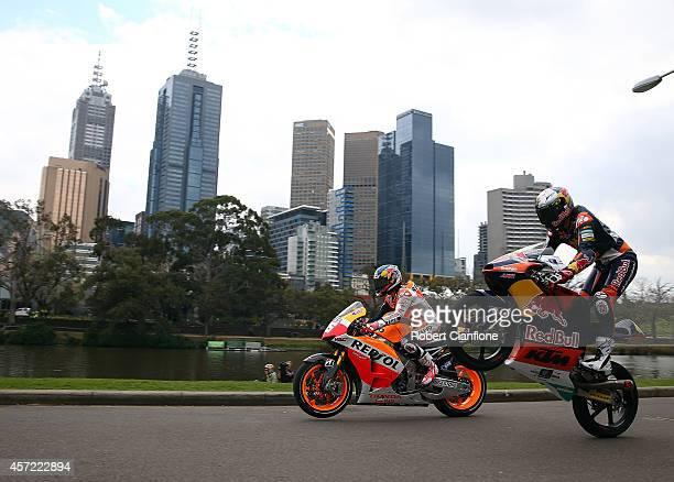 Australian Moto3 rider Jack Miller and Spanish MotoGp rider Dani Pedrosa ride their motorbikes during a bike run on Yarra River on October 15, 2014...