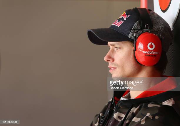 Australian MotoGP rider Casey Stoner looks on in the Team Vodafone garage during qualifying for the Sandown 500 which is round 10 of the V8 Supercars...