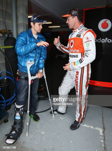 Australian MotoGP rider Casey Stoner talks with Team Vodafone driver craig Lowndes after practice for the Sandown 500 which is round 10 of the V8...