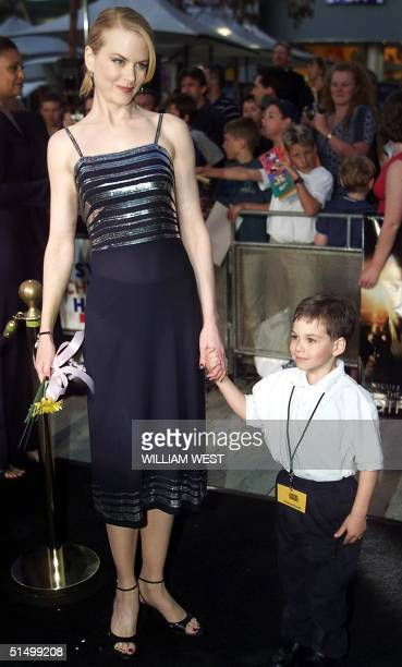 Australian movie star Nicole Kidman is escorted in by cancer suffer sevenyearold Thomas Powell to the Sydney premier of Kidman's new movie The Others...