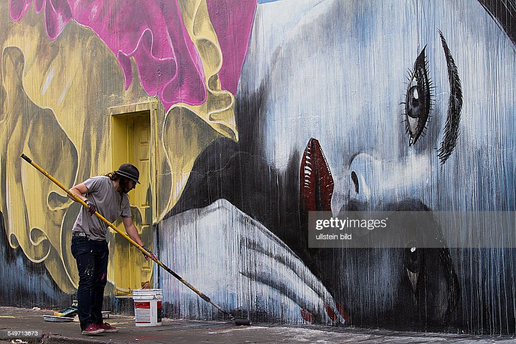Mural painter at work : News Photo