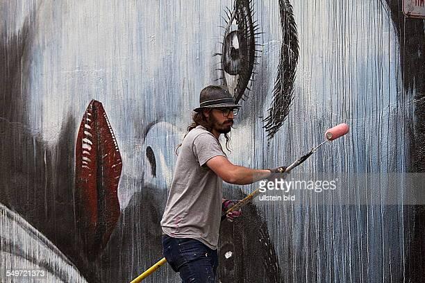 australian mural painter Rone in Tenderloin District in San Francisco California USA