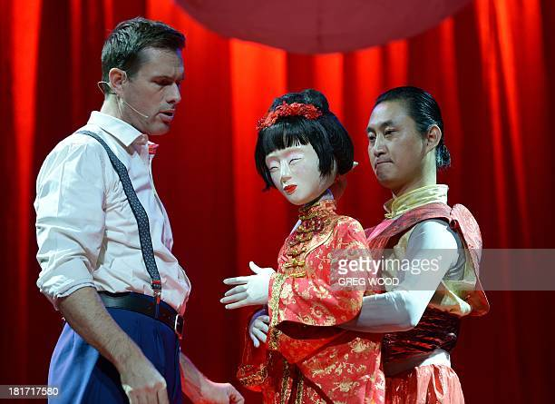 Australian musical theatre star Scott Irwin rehearses with puppet 'Butterfly' and puppeteer Han Xing in a scene from the award winning...