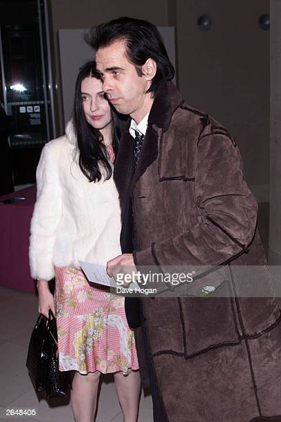 Australian musician Nick Cave and wife arrive at the presentation of the Turner Prize at the Tate Gallery on December 9 2001 in London