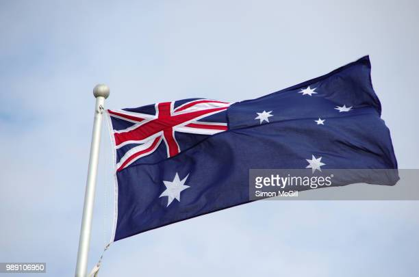 australian national flag flying in the wind - australian flag stock pictures, royalty-free photos & images