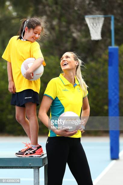 Australian Netball captain Caitlin Bassett poses with aspiring netballer Grace during the Australian Netball Commonwealth Games Team Announcement at...