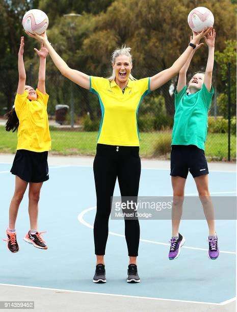Australian Netball captain Caitlin Bassett poses with aspiring netballers Grace and Morgan during the Australian Netball Commonwealth Games Team...