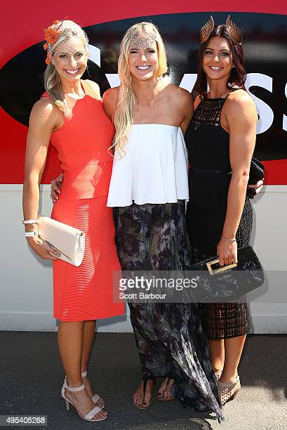 Australian netballers Laura Geitz Caitlin Bassett and Sharni Layton in The Swisse Marquee on Melbourne Cup Day at Flemington Racecourse on November 3...