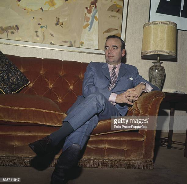 Australian newspaper publisher and businessman Rupert Murdoch pictured sitting on a sofa at home in Sussex Gardens London on 4th October 1969 Rupert...