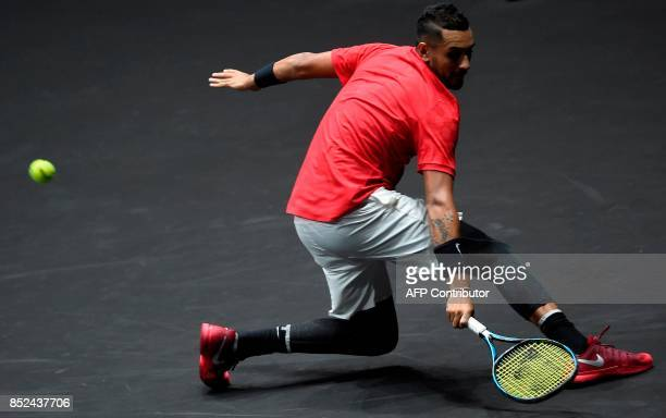 Australian Nick Kyrgios of Team World returns the ball during his match against Czech Republic's Tomas Berdych of Team Europa during the Laver Cup on...