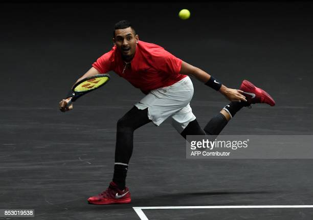 Australian Nick Kyrgios of Team World returns the ball to Swiss Roger Federer of Team Europe during third day of Laver Cup on September 24 2017 in O2...