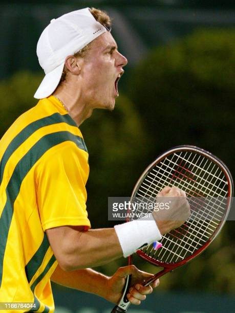 Australian number one Lleyton Hewitt shouts out after winning a point on the way to defeating Switzerland's Michel Kratochvil in the opening match of...
