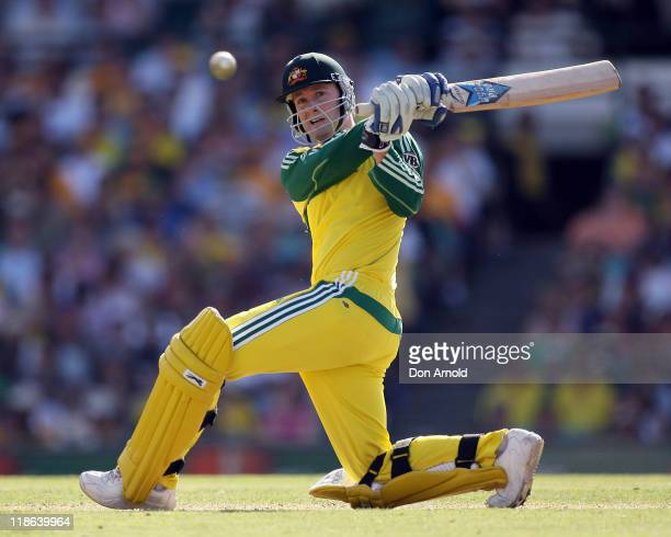 Australian number six batsman Michael Clarke pays close attention to the flight of the sweep shot he has just executed off the bowling of Graham...