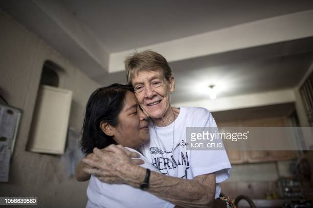 Australian nun Patricia Fox hugs a supporter as she leaves her house on November 3, 2018. - The Australian nun who battled a government bid to expel...