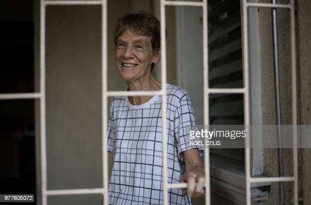 Australian nun Patricia Fox smiles inside her house in Manila on June 18 2018 An Australian nun ordered to leave the Philippines after angering...
