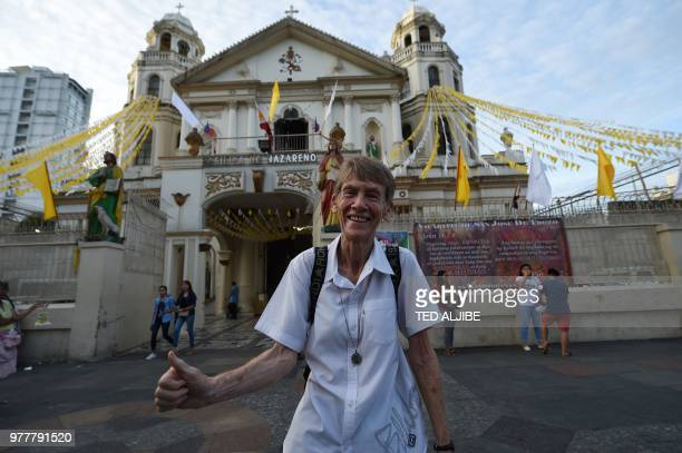 Australian nun Sister Patricia Fox gives a thumbs up sign in front of Quiapo church in Manila on June 18 hours after the justice department nullified...