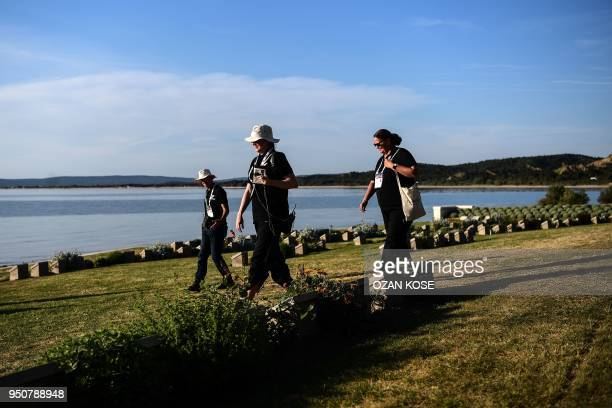 Australian officials pass soldier's gravestones at the Anzac cove in Canakkale on April 24 before a ceremony marking the 103rd anniversary of ANZAC...