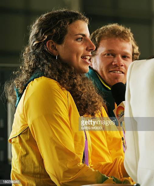 Australian Olympian Jessica Fox is interviewed after disembarking from a Qantas 747400 plane inside a hangar at the Sydney Domestic Airport on August...