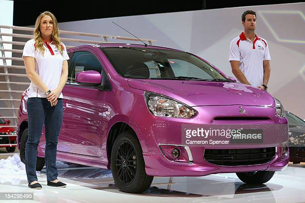 Australian Olympians Sally Pearson and James Magnussen pose with the new Mitsubishi Mirage during the Australian International Motor Show media...