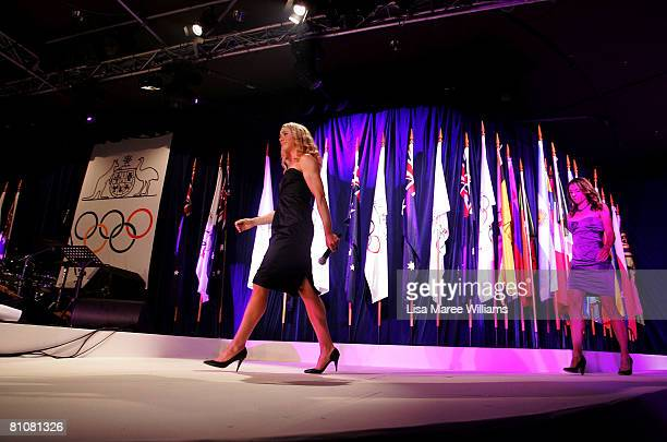 Australian Olympic athletes Amber Halliday and Marguerite Houston arrive on stage during the Bound for Beijing appeal dinner for the 2008 Australian...