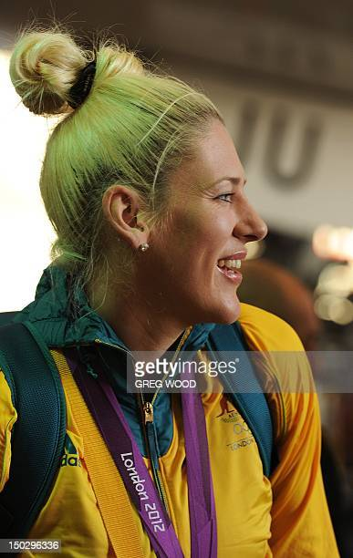 Australian Olympic basketballer Lauren Jackson disembarks from a Qantas 747400 plane inside a hangar at the Sydney Domestic Airport on August 15 2012...