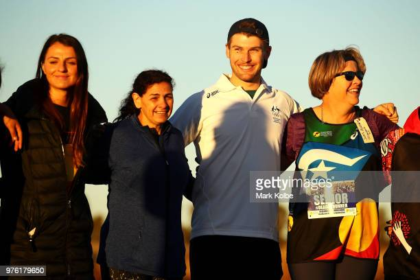 Australian olympic bobsledder Hayden Smith stands with other runners as they compete in the Deadly Fun Run during the the National Deadly Fun Run...