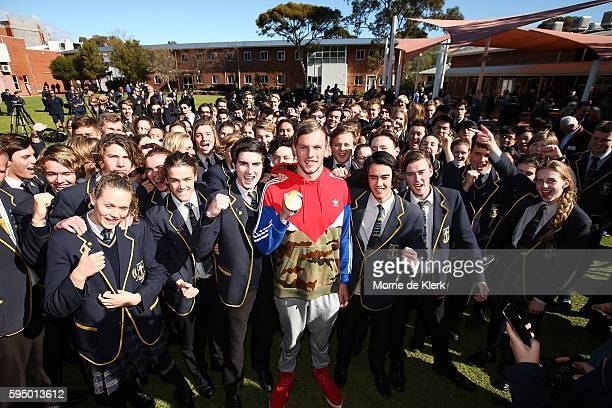 Australian Olympic Games gold medallist Kyle Chalmers shows his medal to students at Immanuel College on August 25 2016 in Adelaide Australia