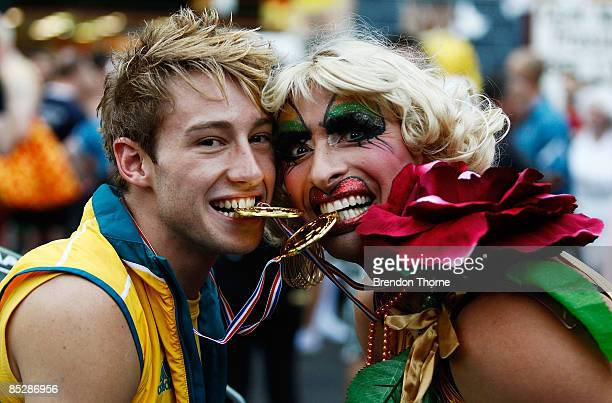 Australian Olympic golf medal winning diver Matthew Mitcham poses with Joyce Maynge prior to the annual Sydney Gay and Lesbian Mardi Gras Parade on...