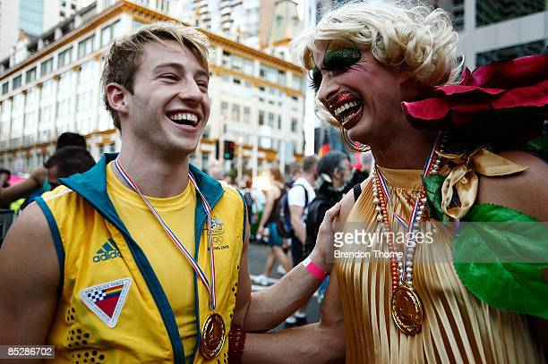 Australian Olympic gold medal winning diver Matthew Mitcham shares a joke with Joyce Maynge during the annual Sydney Gay and Lesbian Mardi Gras...