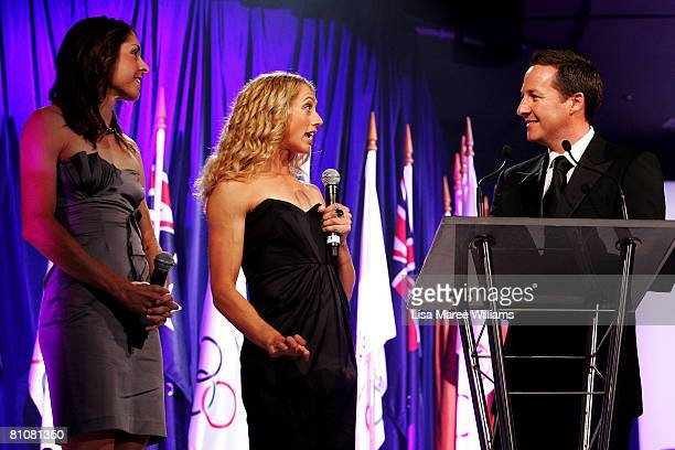 Australian Olympic Rowers Marguerite Houston and Amber Halliday speak with host Matt White during the 2008 Australian Olympic Team dinner at the...