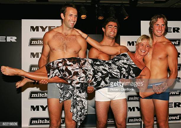 Australian Olympic swimmer Brooke Hanson poses with Shane Wakelin of the Coliingwood football club, Anthony Minichiello of the Sydney Roosters and...