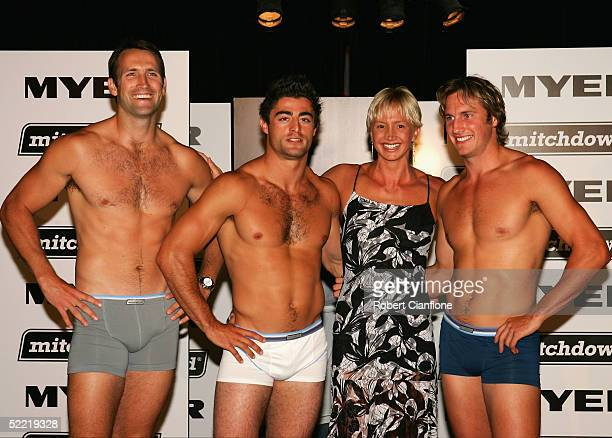 Australian Olympic swimmer Brooke Hanson posese with Shane Wakelin of the Coliingwood football club, Anthony Minichiello of the Sydney Roosters and...
