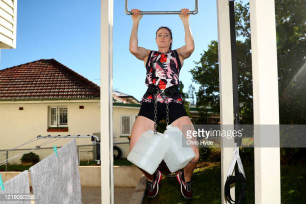 Australian Olympic swimmer Cate Campbell trains in isolation at her house on April 16, 2020 in Brisbane, Australia. Athletes across the globe are now...