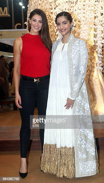 Australian Olympic swimmer Stephanie Rice and Indian Bollywood actress Sonam Kapoor pose as they attend The Women Entrepreneur Exhibition in Mumbai...
