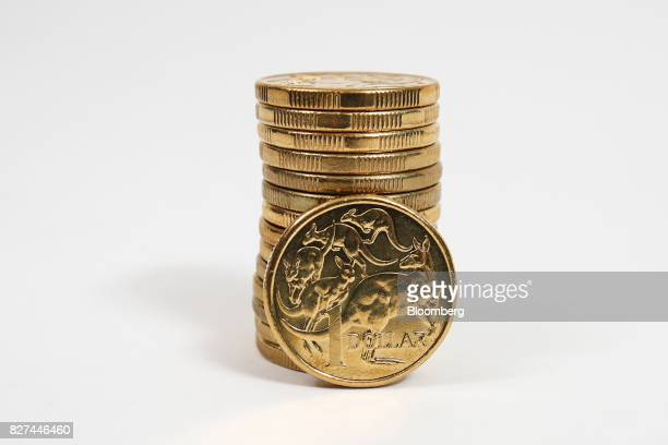 Australian one dollar coins are arranged for a photograph in Sydney Australia on Friday Aug 4 2017 The Australiandollarrose for the first time in...