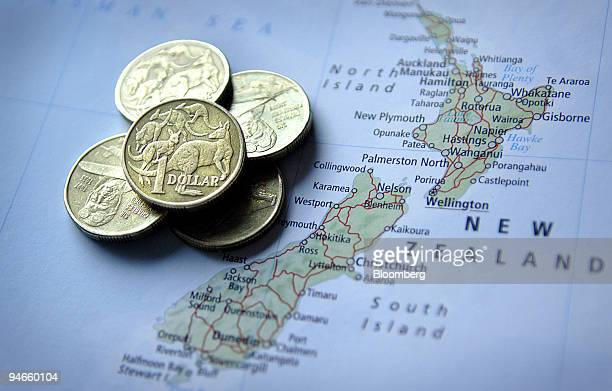 Australian one dollar coins are seen against a map of New Zealand in Sydney Australia on Tuesday Aug 7 2007 The Australian and New Zealand dollars...